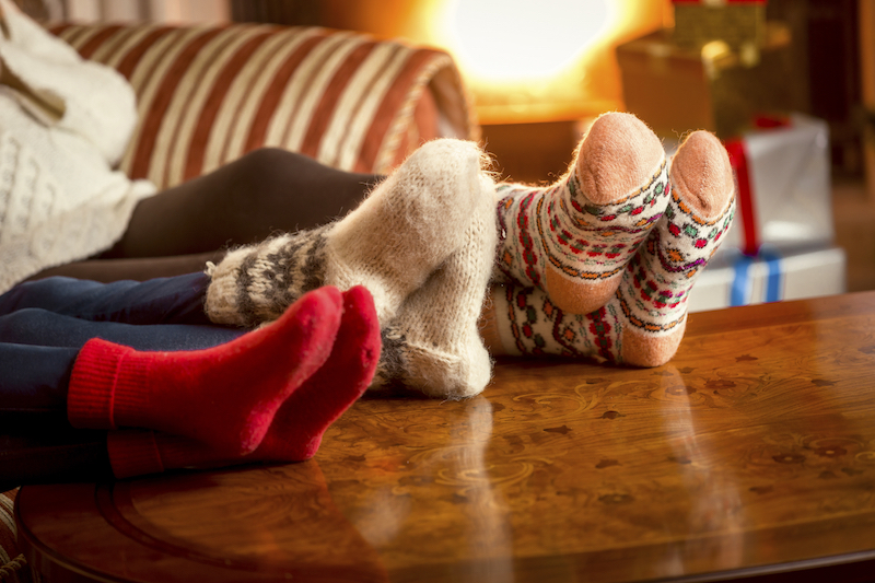 family warming feet at fireplace